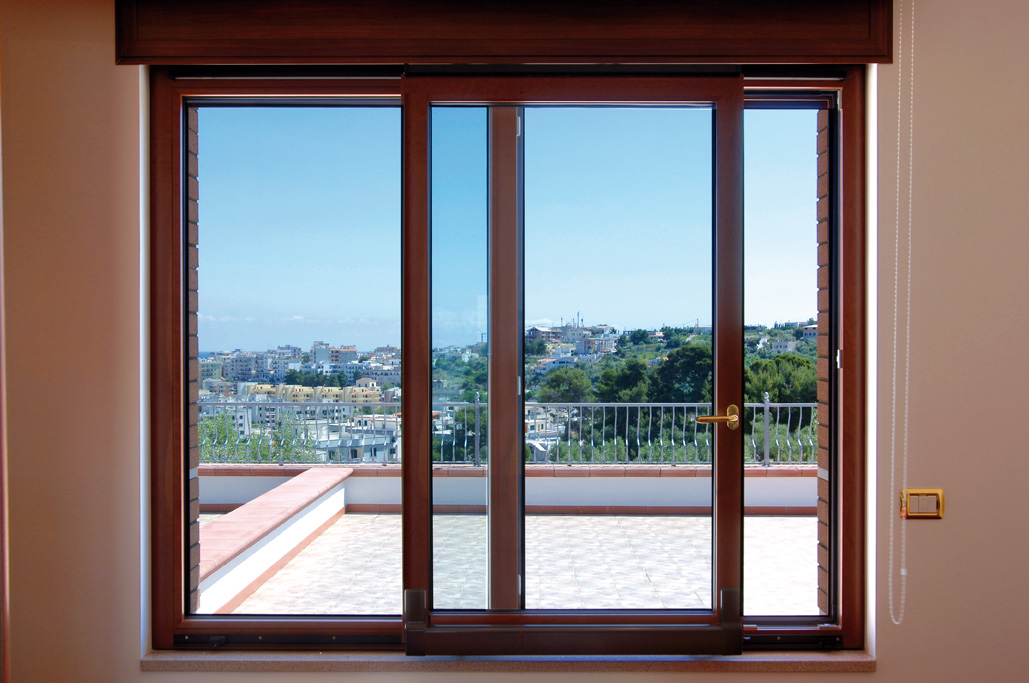 Finestre e porte finestre scorrevoli scorrevoli renna for Infissi balcone